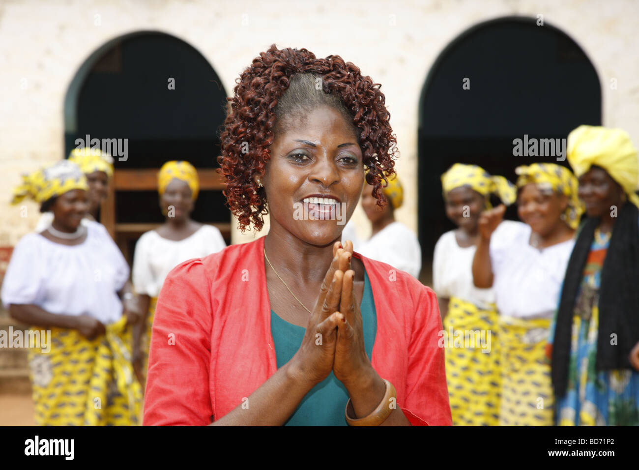 Woman dancing with a church women's group, chief farmstead of the Fon, Bafut, West Cameroon, Cameroon, Africa - Stock Image