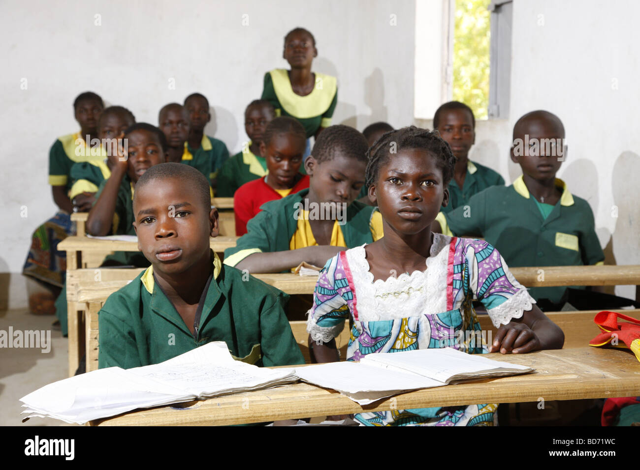 Girl without uniforms with classmates in uniform, during lessons, Mora, Cameroon, Africa - Stock Image