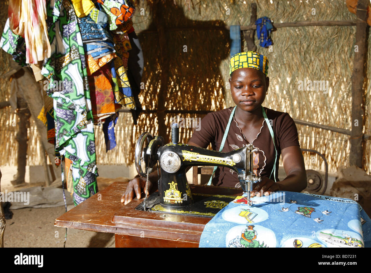 Woman using a sewing machine, working from home, Maroua, Cameroon, Africa - Stock Image