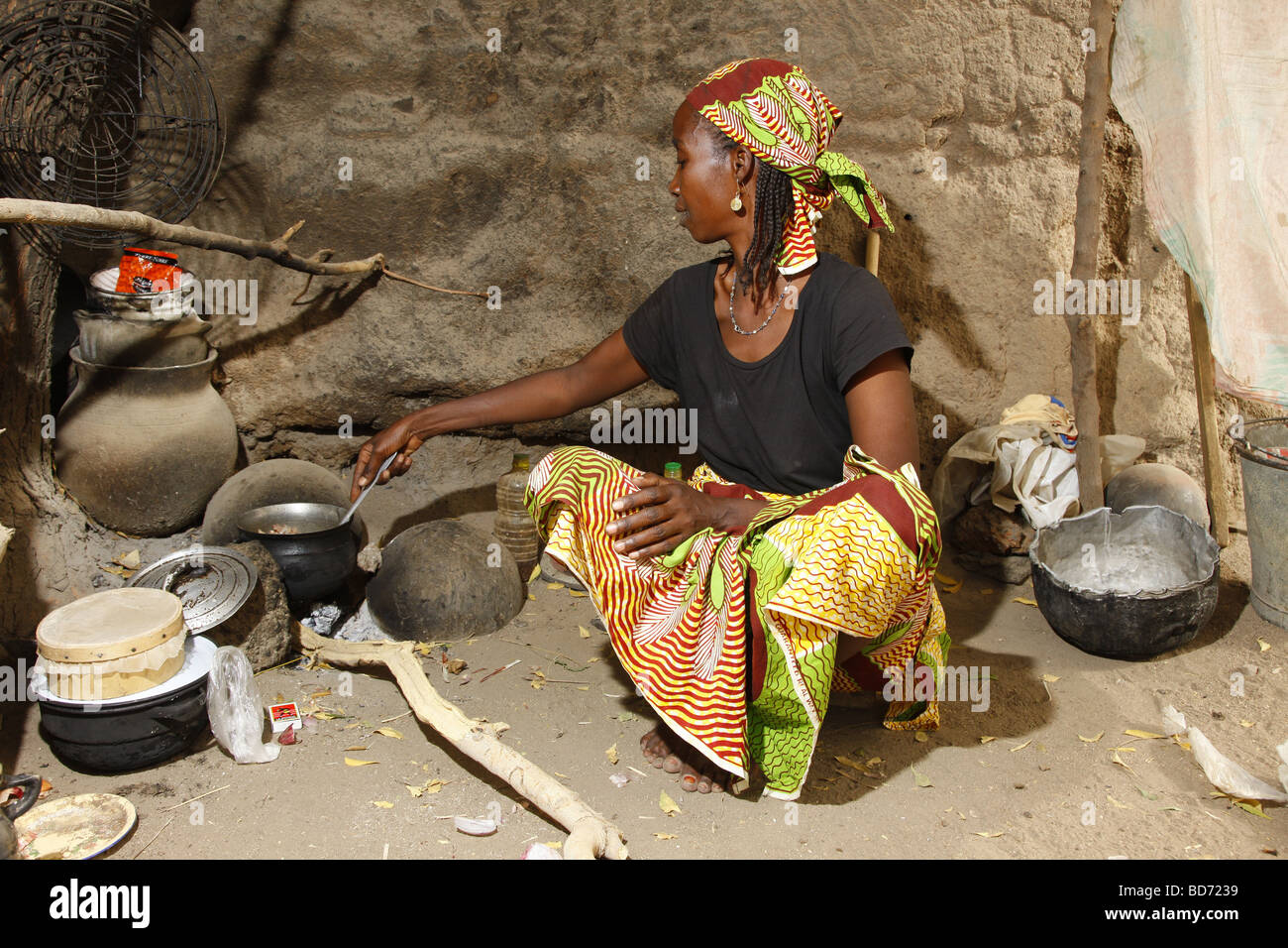 Woman cooking at the fireplace in a house, Maroua, Cameroon, Africa - Stock Image