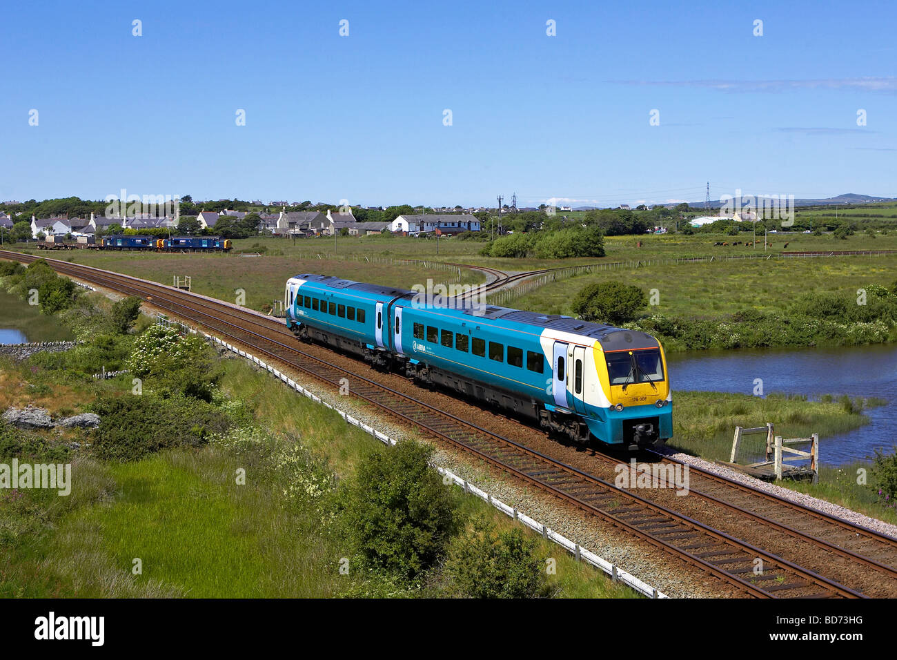 Arriva Trains Wales 175 008 passes Valley on Anglesey - Stock Image