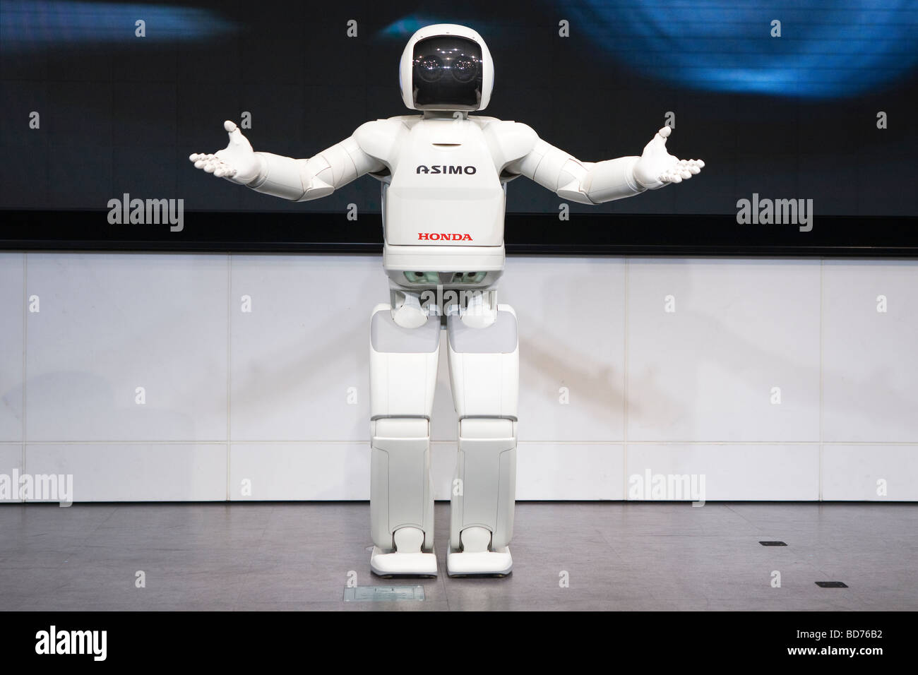 Asimo A Humanoid Robot Created By Honda Giving Performance On Stage At The Company Headquarters In Tokyo