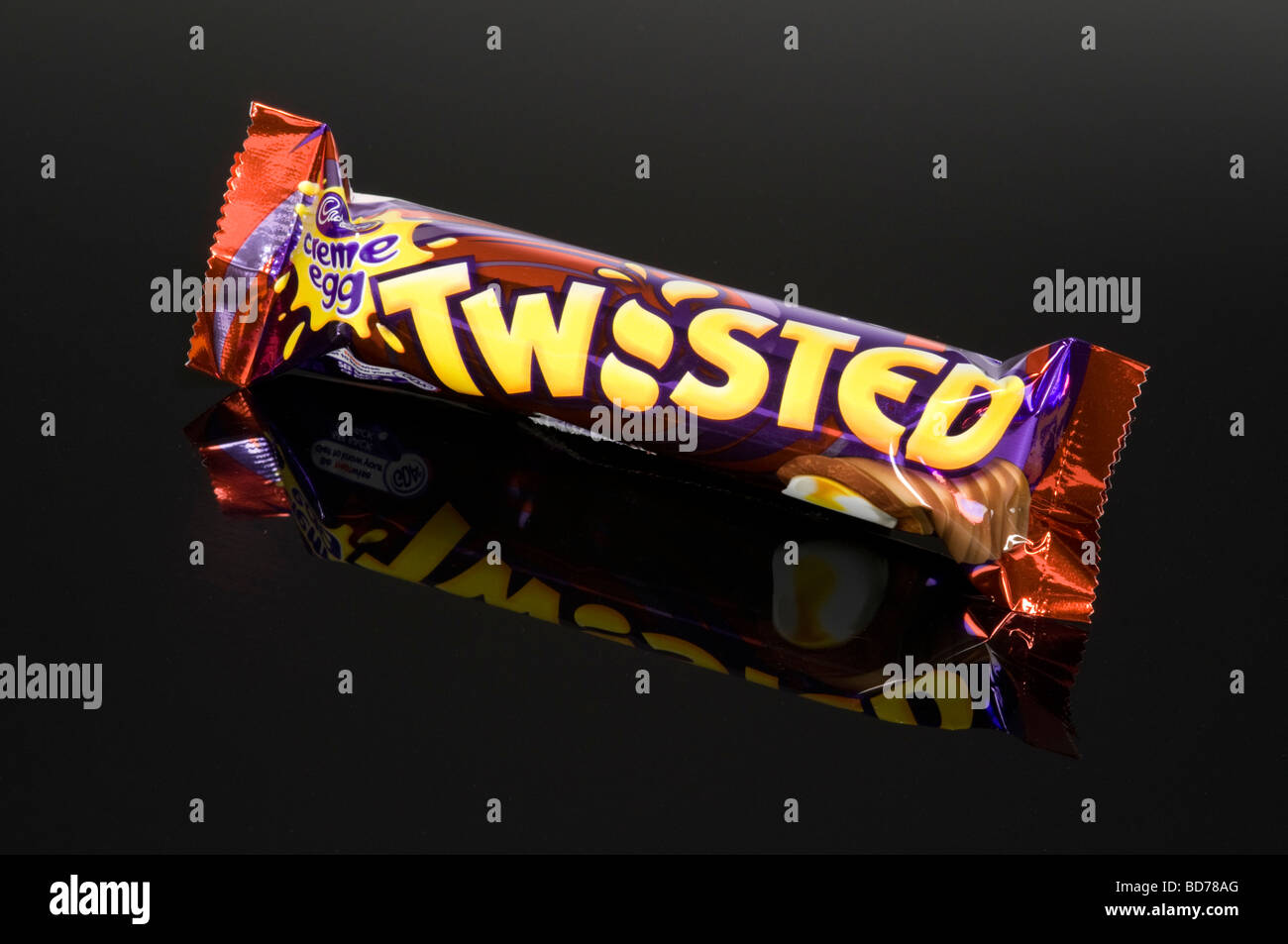 Creme Egg Twisted Chocolate Bar On Black Background Shot In Studio - Stock Image