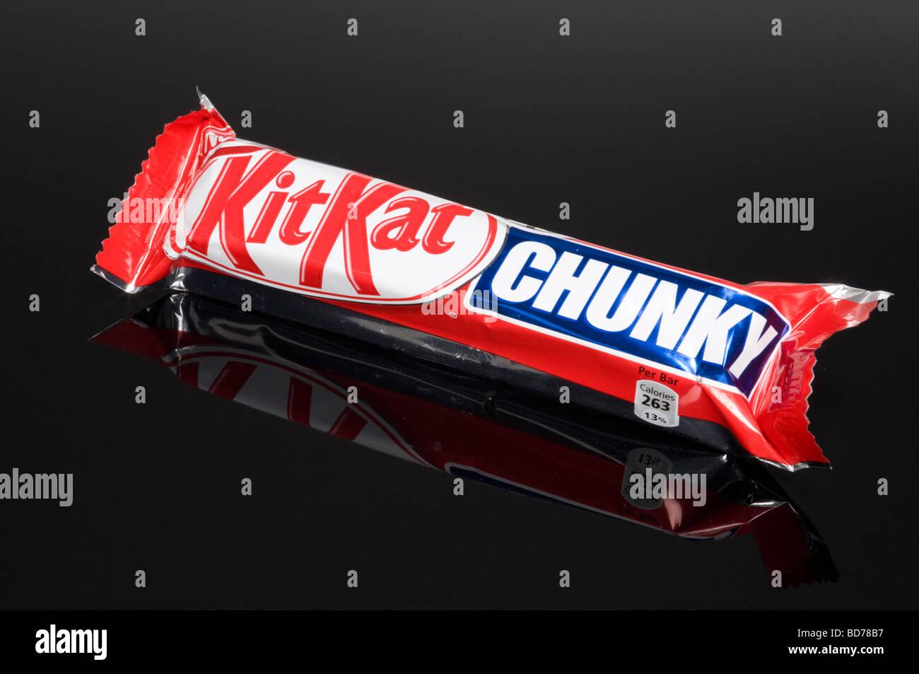 Nestle KitKat Chunky Chocolate Bar On Black Background Shot In Studio - Stock Image