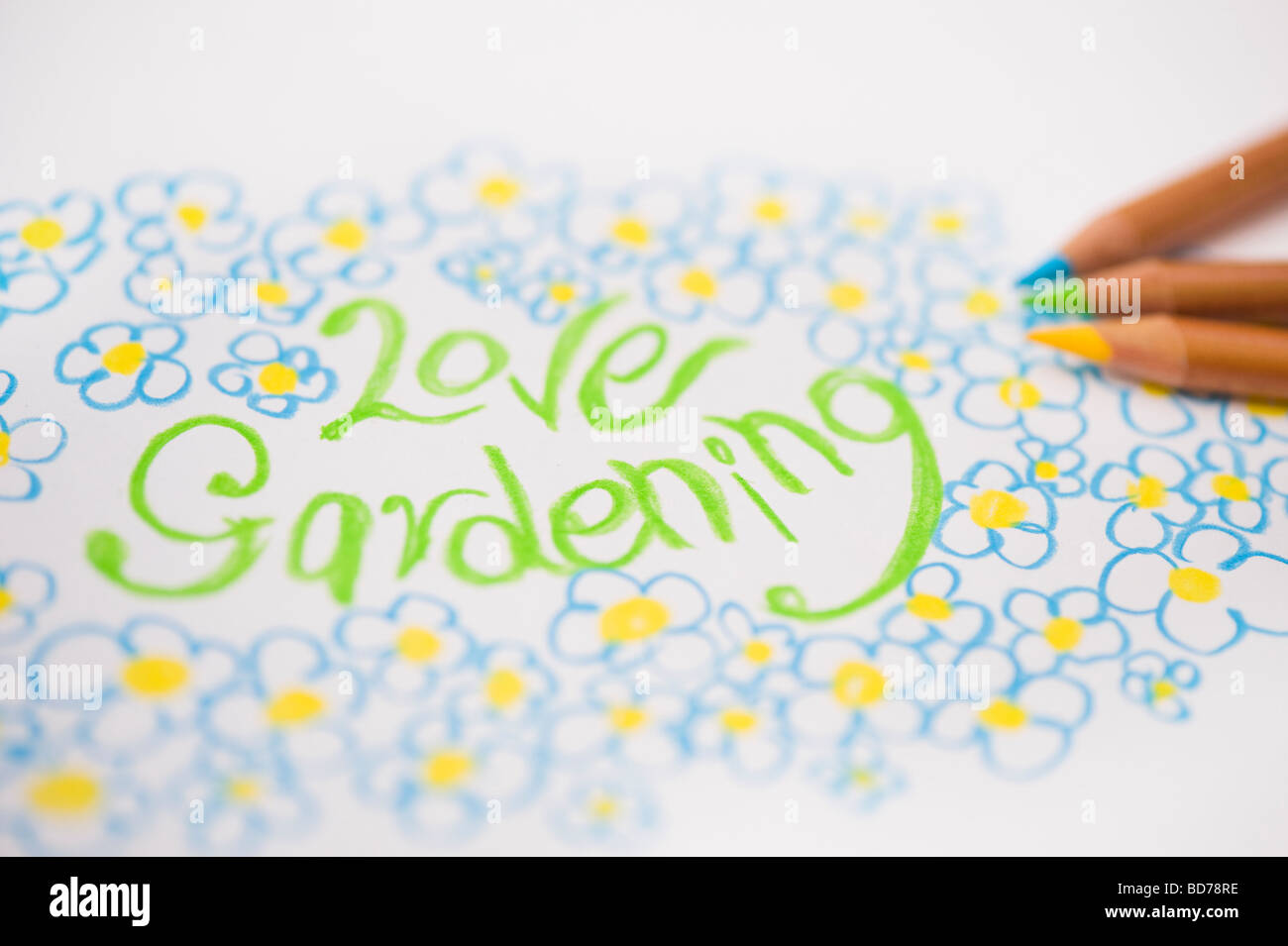 Love gardening and flowers, child's drawing and colouring pencils - Stock Image