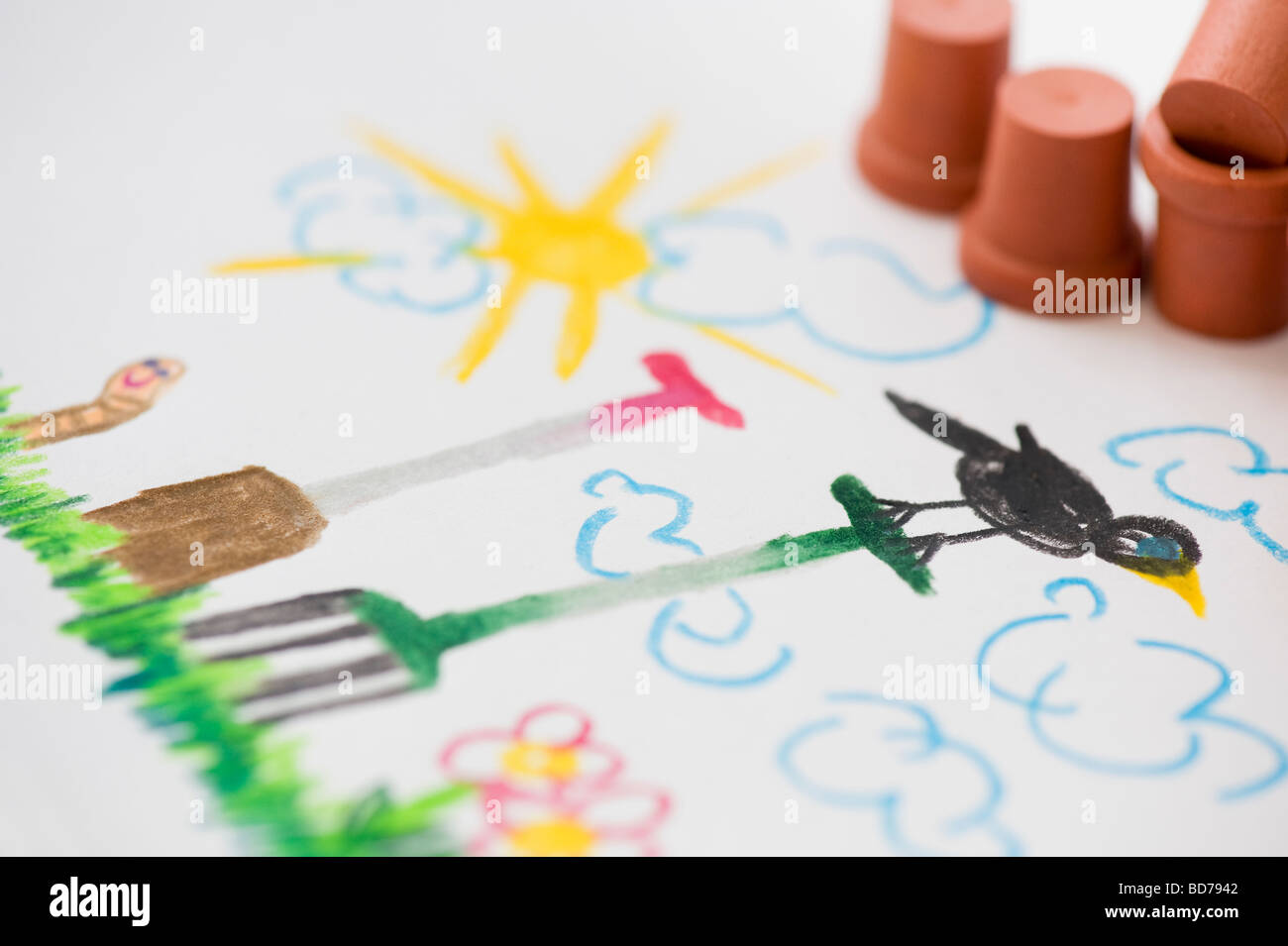 Garden scene with garden tools and flower pots , child's drawing in coloured pencils - Stock Image