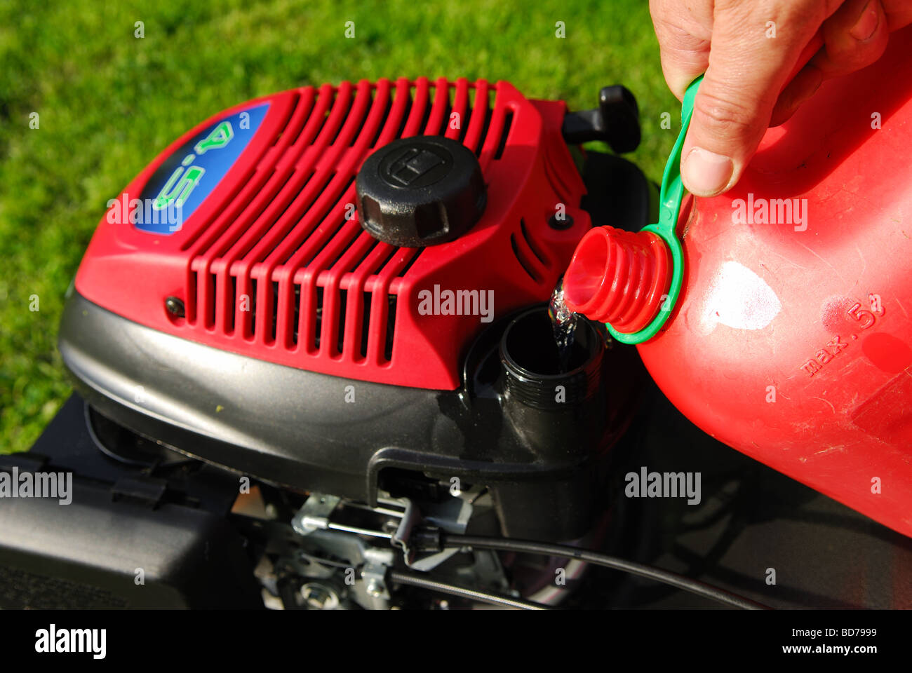 Lawnmower Fuel Refill. - Stock Image