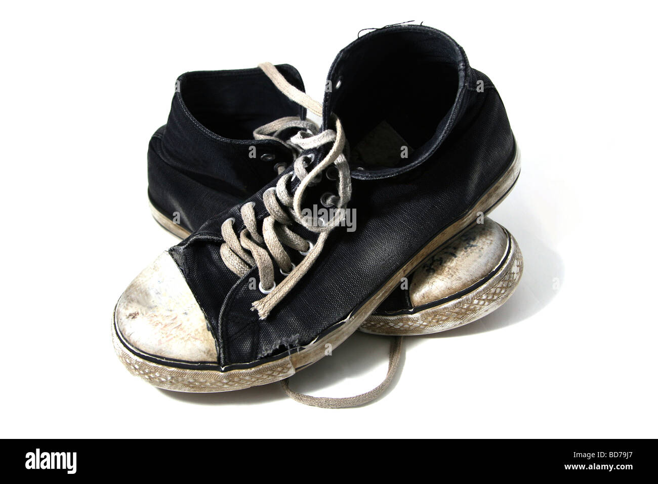 Old worn out sneakers - Stock Image