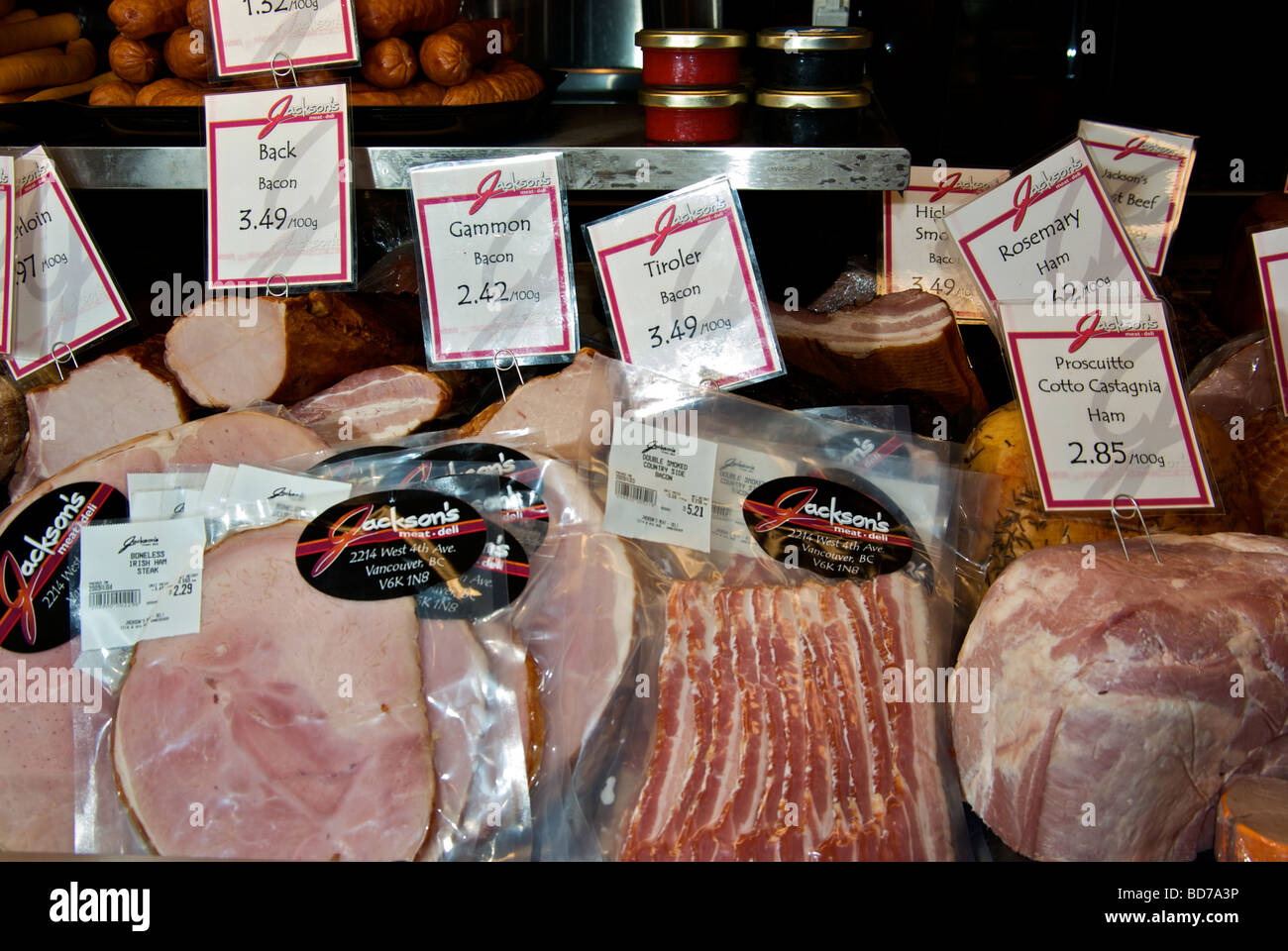 Delicatessen specialty cured meats hams bacon sausage - Stock Image