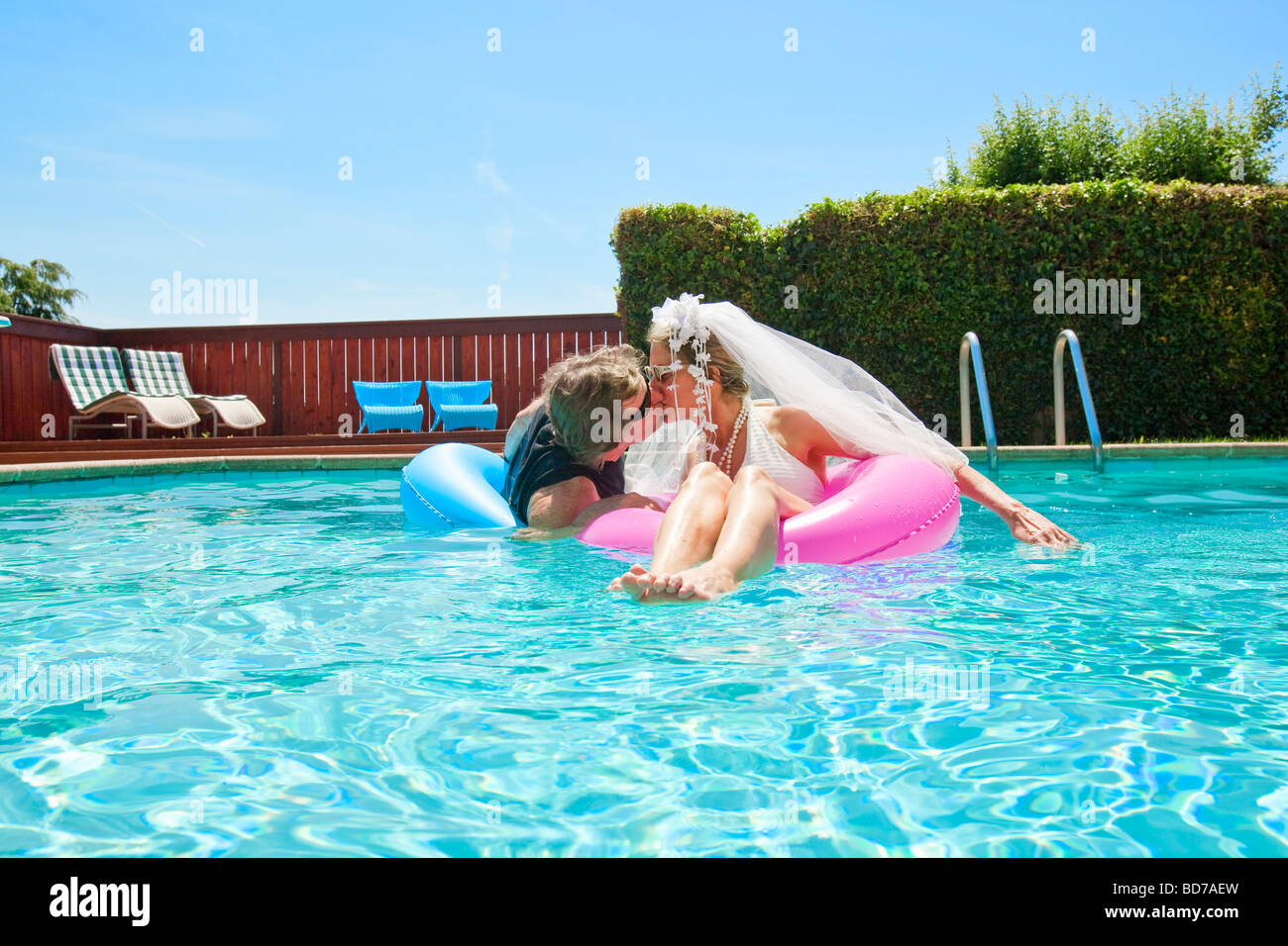 Bride and groom in swimming pool Stock Photo: 25362817 - Alamy