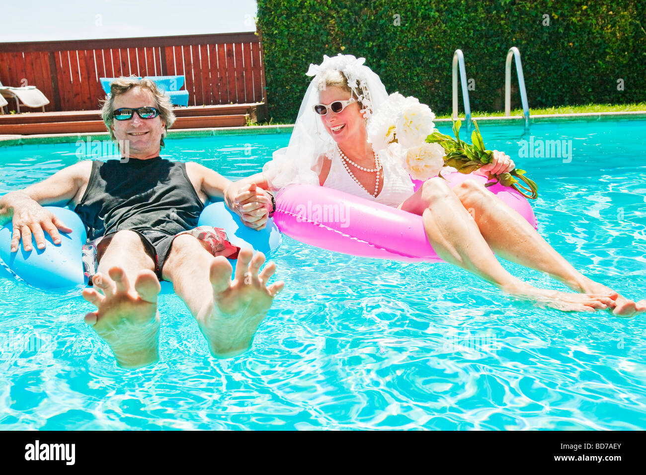 Bride and groom in swimming pool Stock Photo: 25362819 - Alamy
