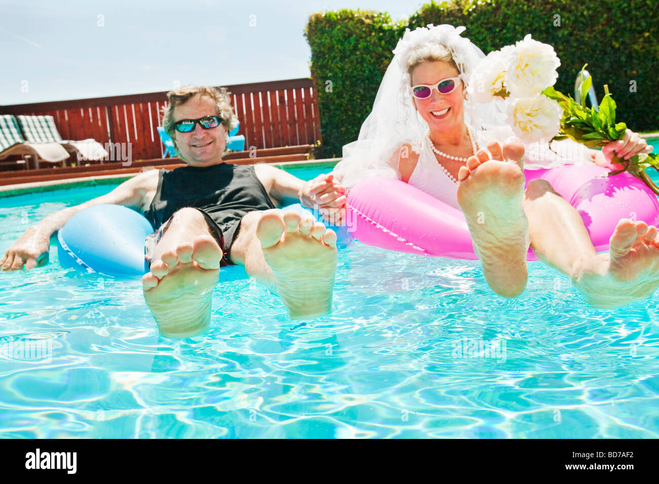Bride and groom in swimming pool Stock Photo: 25362822 - Alamy