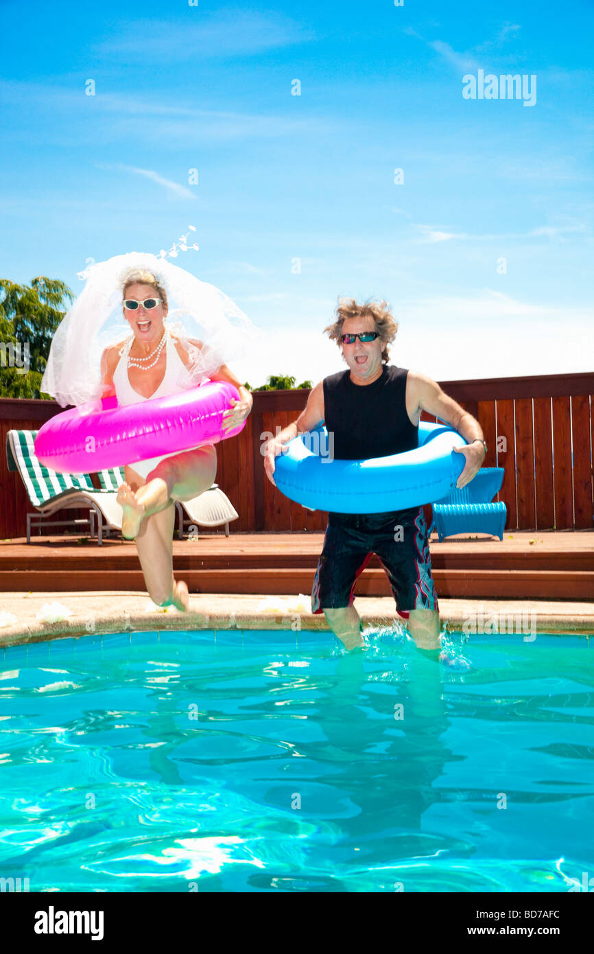 Bride and groom in swimming pool Stock Photo: 25362832 - Alamy