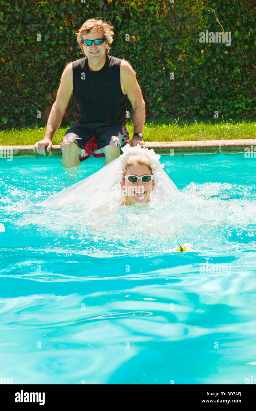 Bride and groom in swimming pool Stock Photo: 25362838 - Alamy