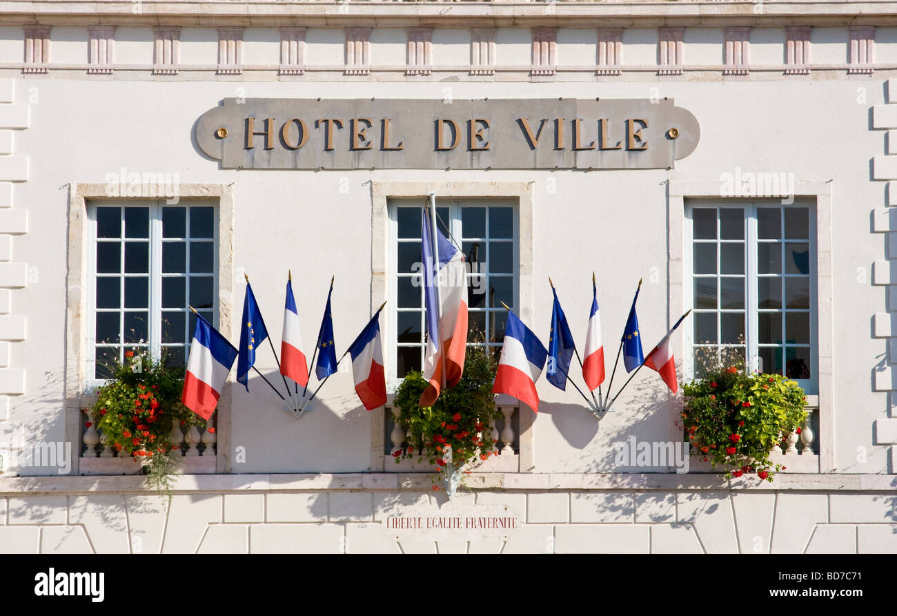 French and european union flags at a city hall frontage Nuits Saint Georges Burgundy France - Stock Image