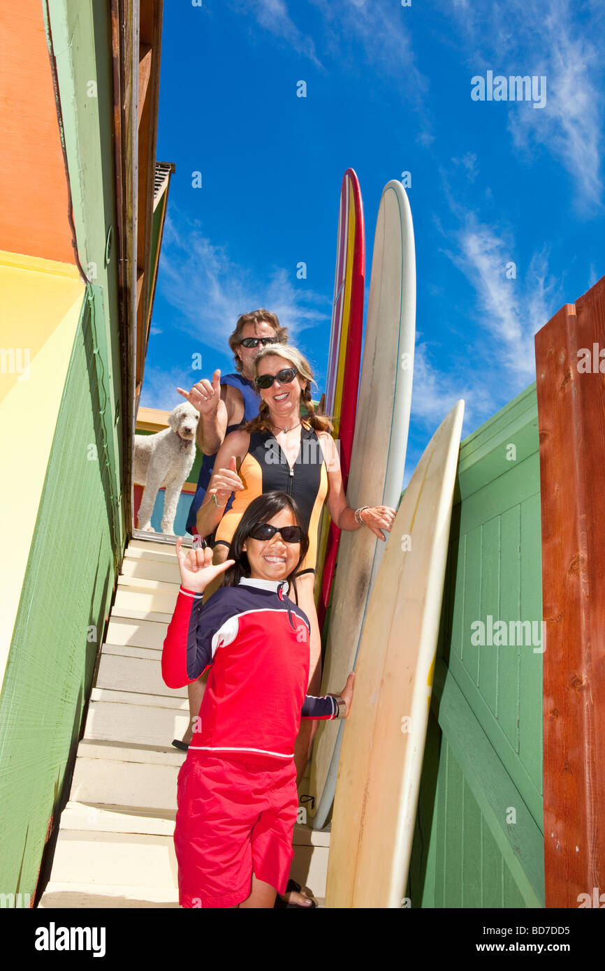 Family with surfboards on stairs Stock Photo