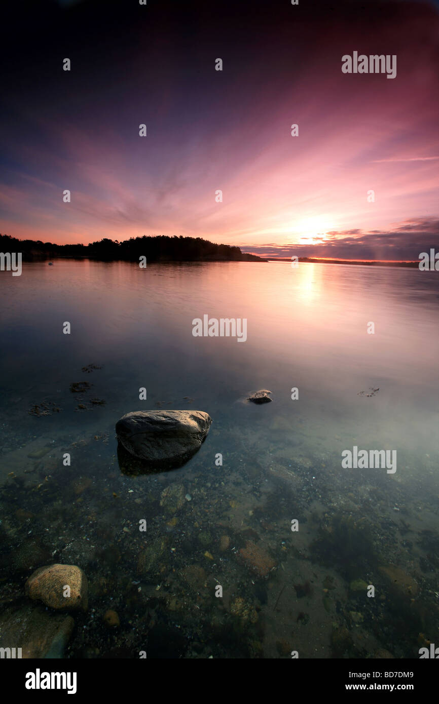 Colorful skies at dawn at Teibern in Larkollen, Rygge kommune, Østfold fylke, Norway. - Stock Image