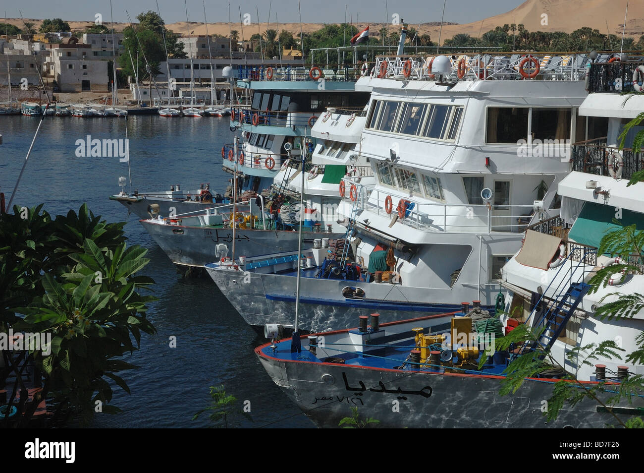 Nile cruiser vessels docked in the Nile River in Aswan southern Egypt - Stock Image