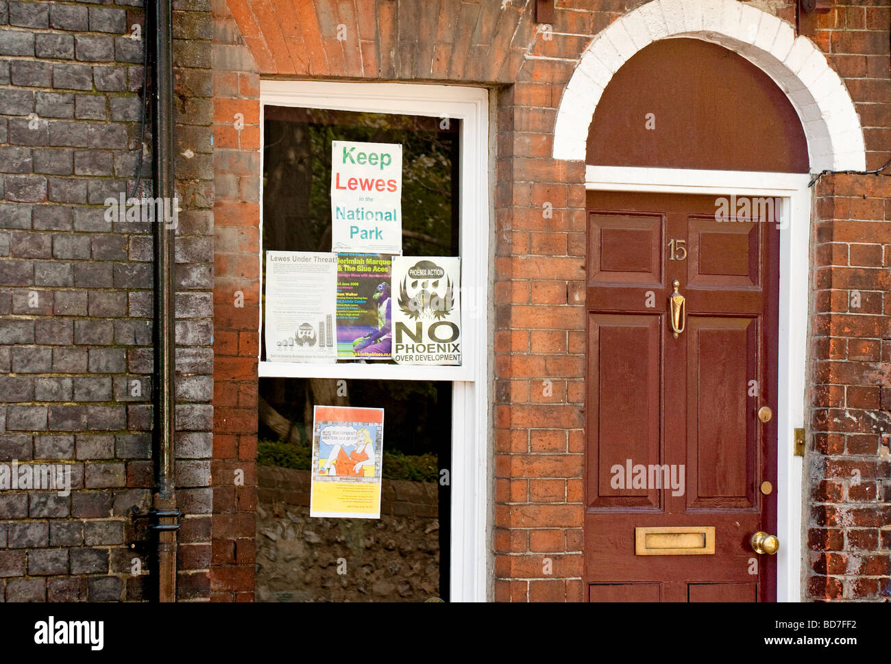 Posters in a window for environmental campaigns and town centre development - Stock Image