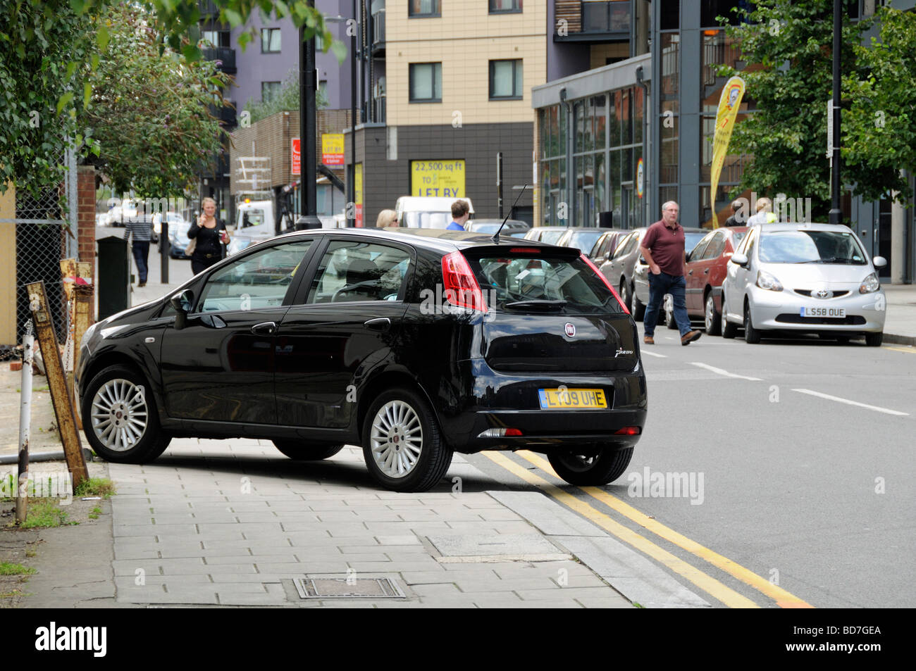 Car parked on pavement Holloway London England UK - Stock Image