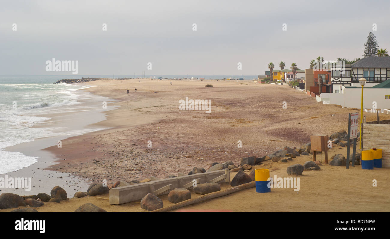 Swakopmund beachfront next to wooden jetty - Stock Image
