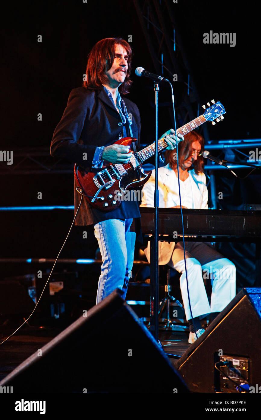 Andre Barreau (George Harrison) and Neil Harrison (John Lennon) at the Oundle International Festival Saturday July - Stock Image