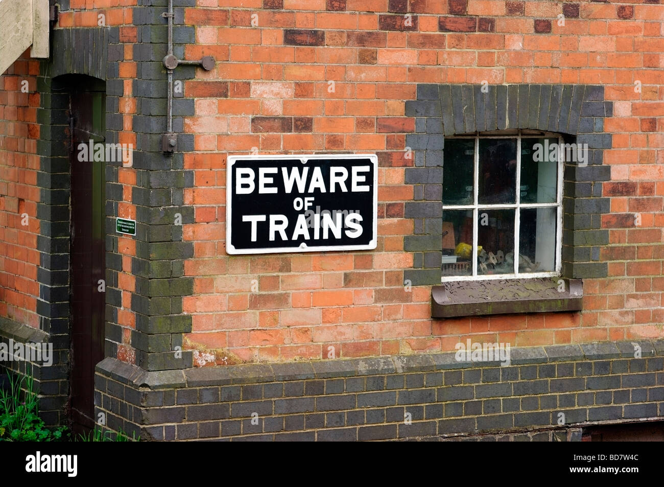 Beware of Trains sign - Stock Image