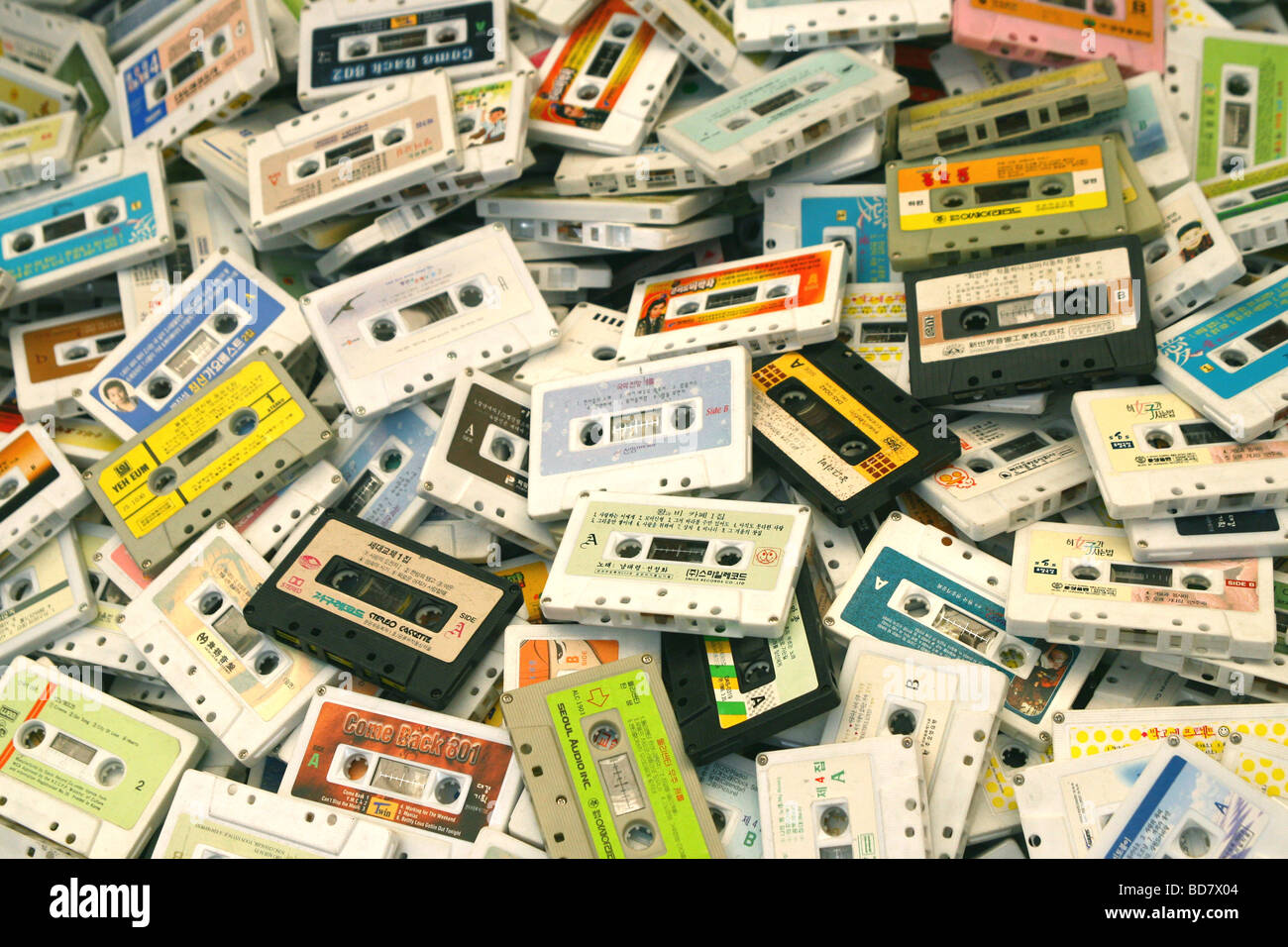 A pile of old audio cassette tapes in a market stall in Seoul, South Korea - Stock Image