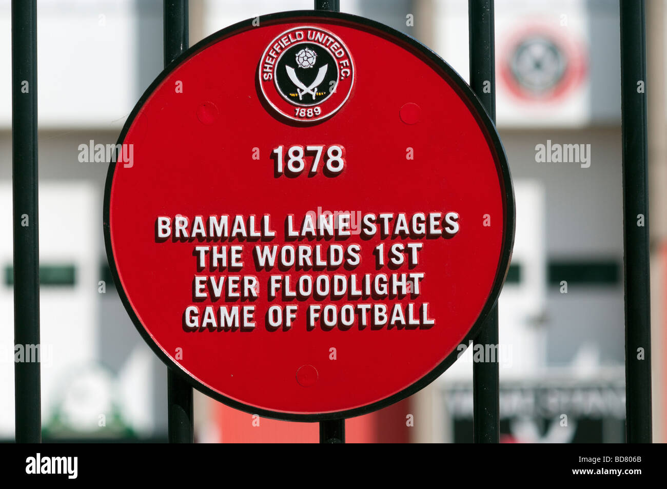 Red circular commemorative plaque 'Bramall Lane' stages the worlds 1st Floodlit game of football - Stock Image