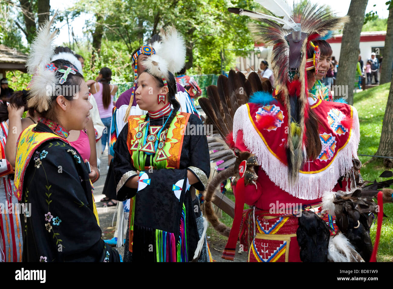 North American Plaims Native Indian in traditional dress at Pow Wow in the Indian Village at the Calgary Stampede - Stock Image