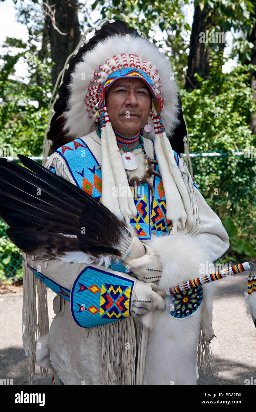 North American Plaims Native Indian in traditional dress at Pow Wow in the Indian Village at the Calgary Stampede Stock Photo