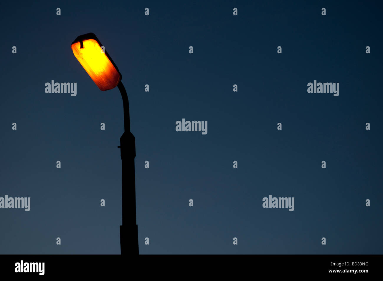 street lamp at night yellow sodium light - Stock Image