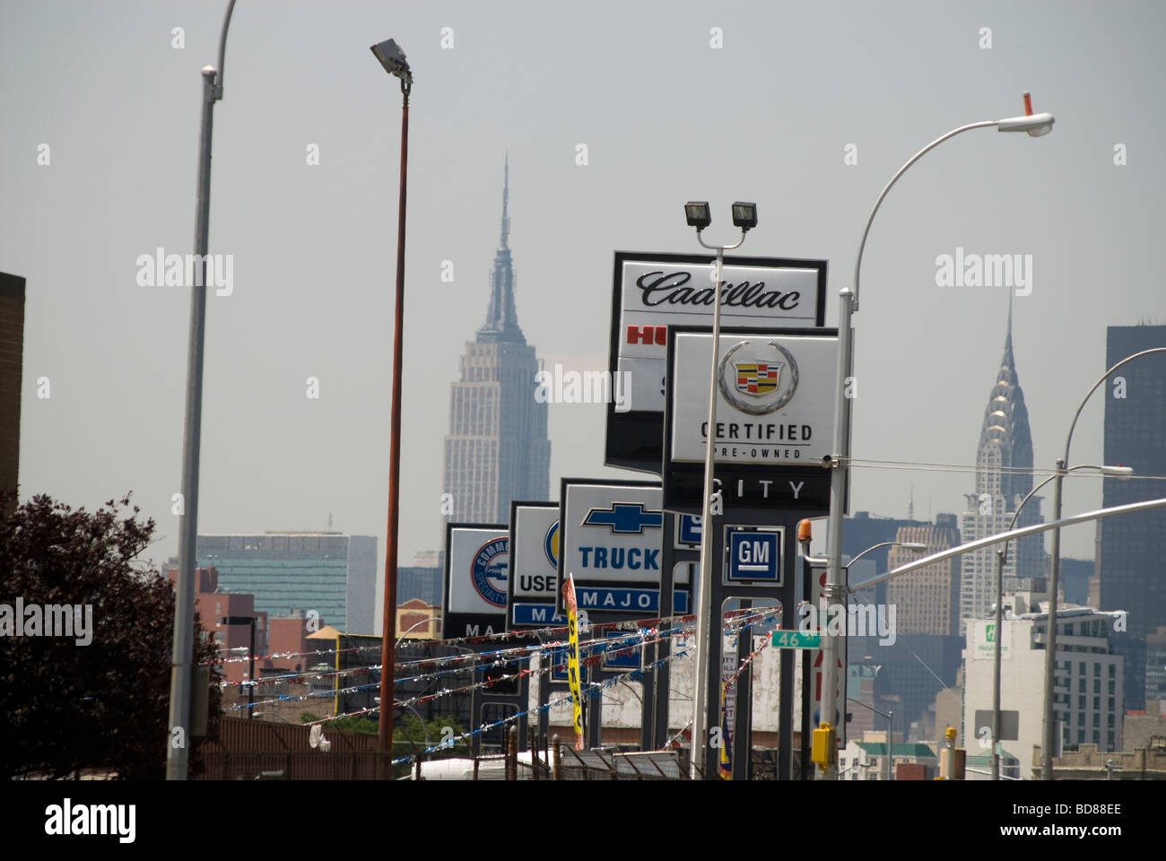 Used and pre owned automobiles are offered for sale at car dealers on Northern Boulevard in the borough of Queens - Stock Image