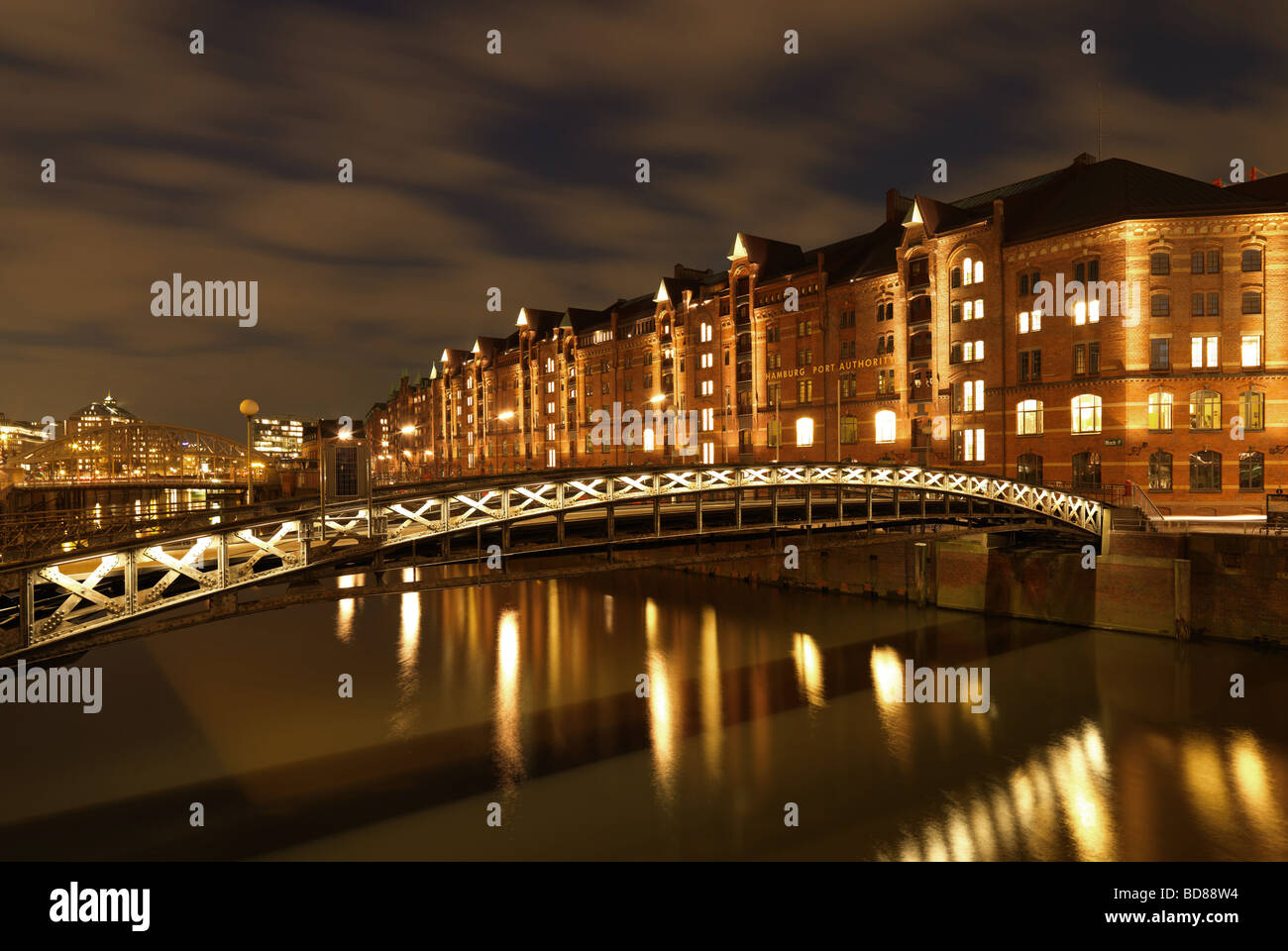 The historic warehouse district of Hamburg, northern Germany under a cloudy sky at the blue hour on Saturday February Stock Photo