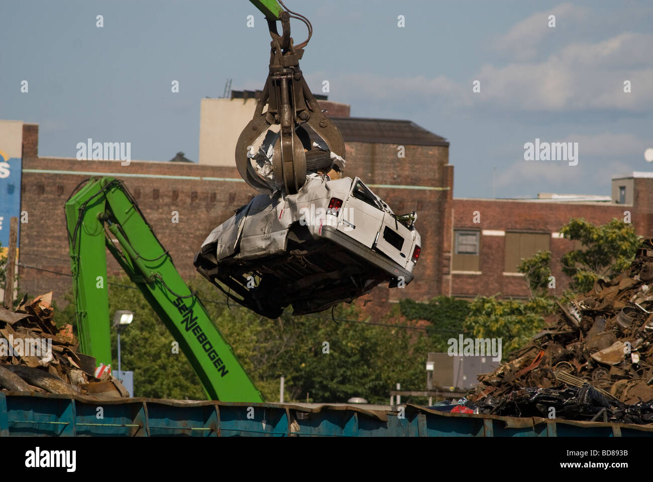 Automobiles at a scrap metal recycler on Newtown Creek separating Brooklyn and Queens counties in New York - Stock Image