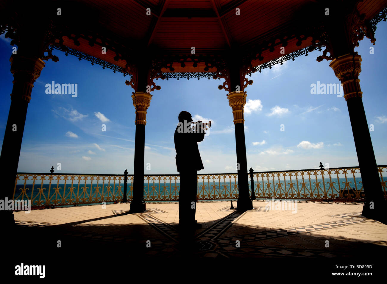 A lone cornet player on Brighton's newly restored bandstand Stock Photo