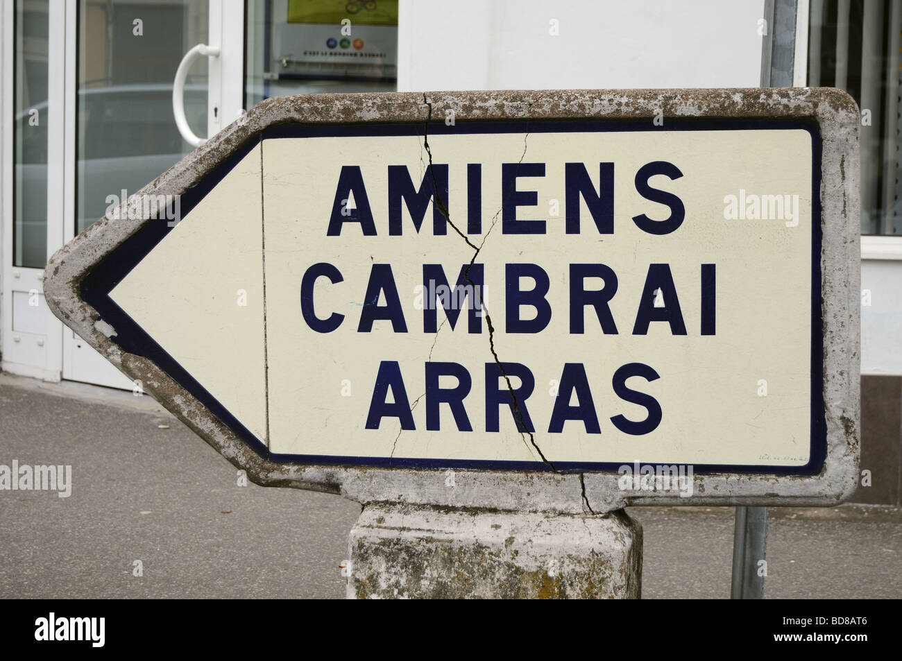 Road sign for world war one towns Amiens Cambrai and Arras - Stock Image