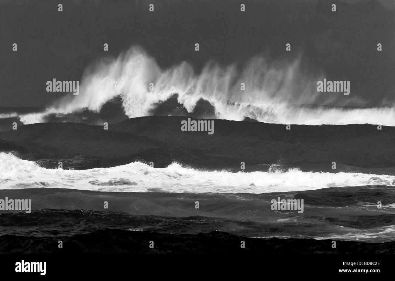Large storm waves off Kauai coast Hawaii - Stock Image