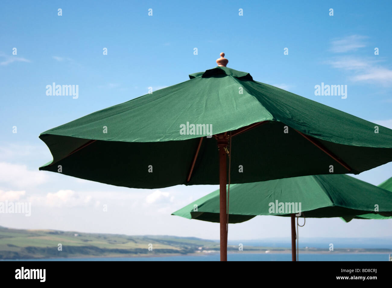 Parasols by the Coast - Stock Image