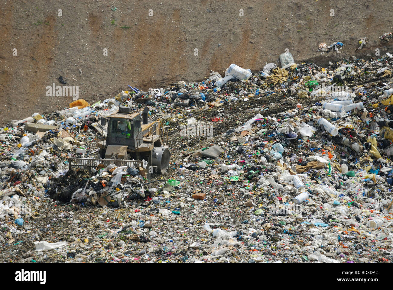 A tractor compactor working in a landfill site in France. (Lorraine region) - Stock Image