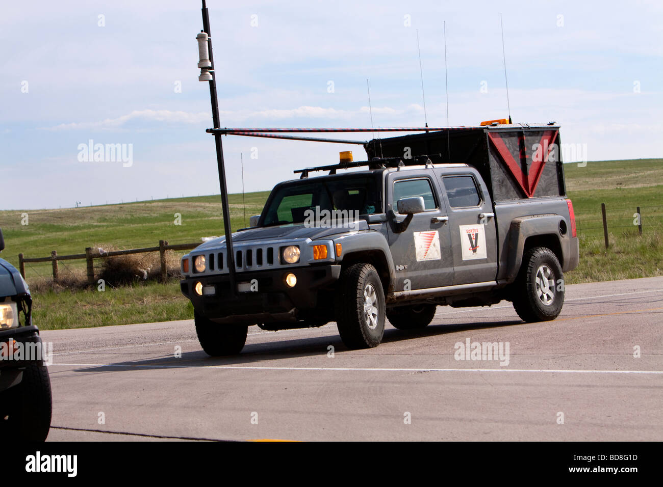 Storm chaser Phil Berg drives his Hummer H3 probe vehicle in southern Kansas June 4 2009 - Stock Image