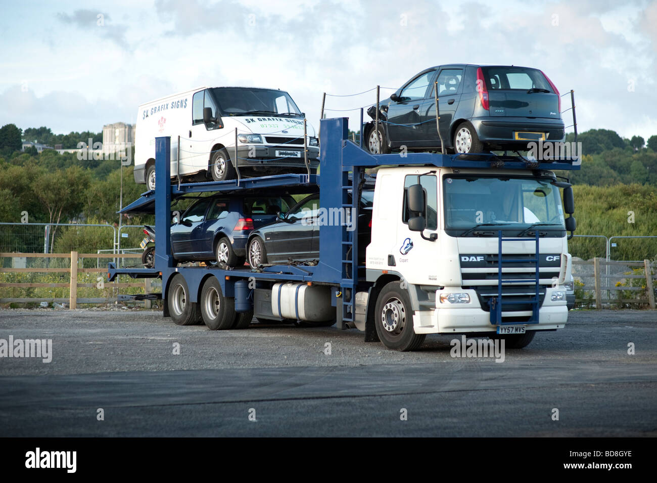 HGV truck Car transporter collecting cars and vans for repair - Stock Image