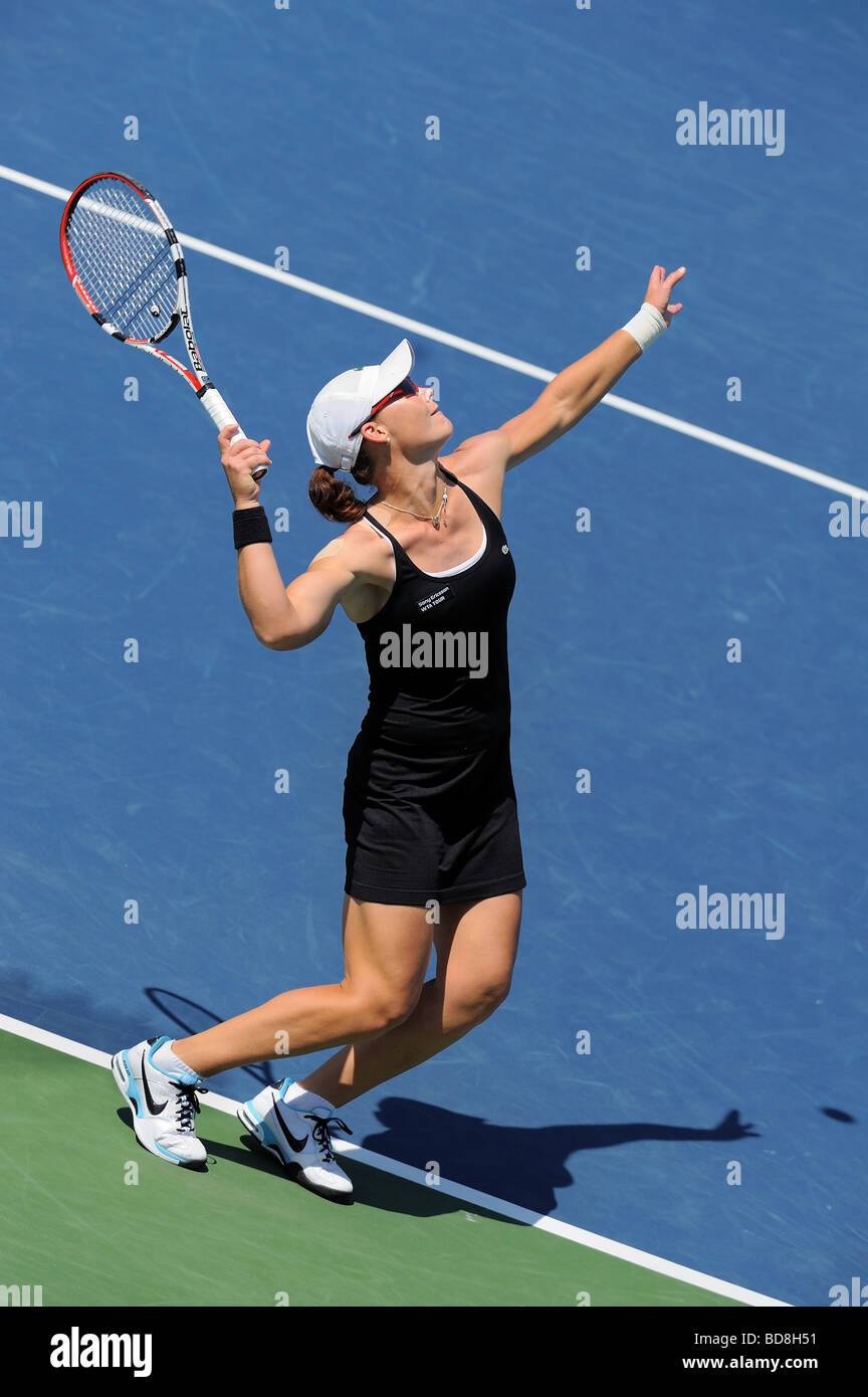 Samantha Stosur of Australia serves to Flavia Penneta during the Los Angeles Open Championship Singles Final. - Stock Image