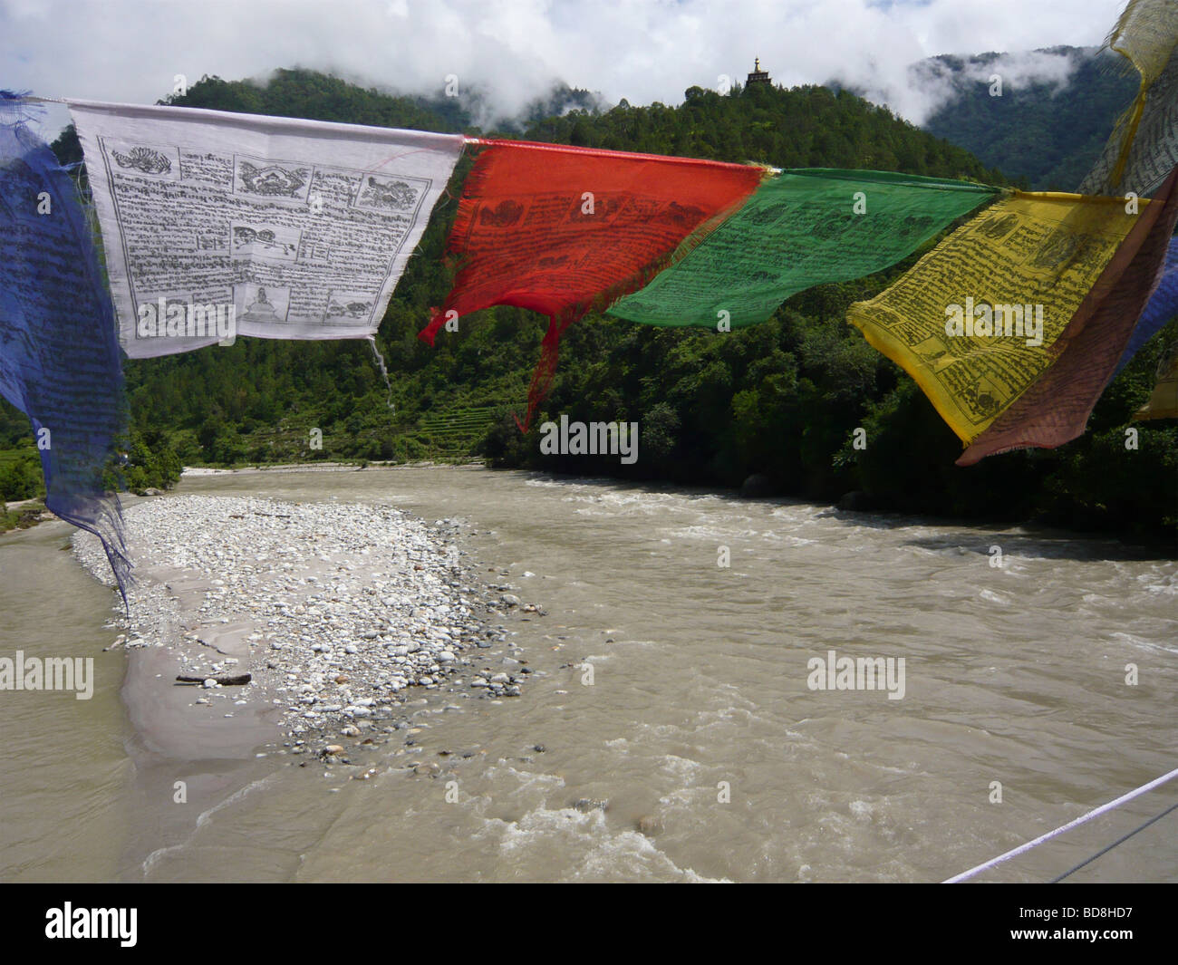 Prayer flags in the wind on the footbridge over the Mo Chhu River to Khamsum Yuelley Namgyal, Punakha , Bhutan - Stock Image
