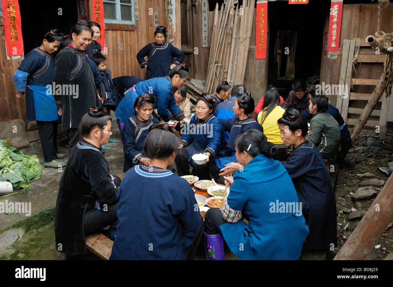 Dong women eating at wedding feast Chejing village Guizhou Province China Stock Photo