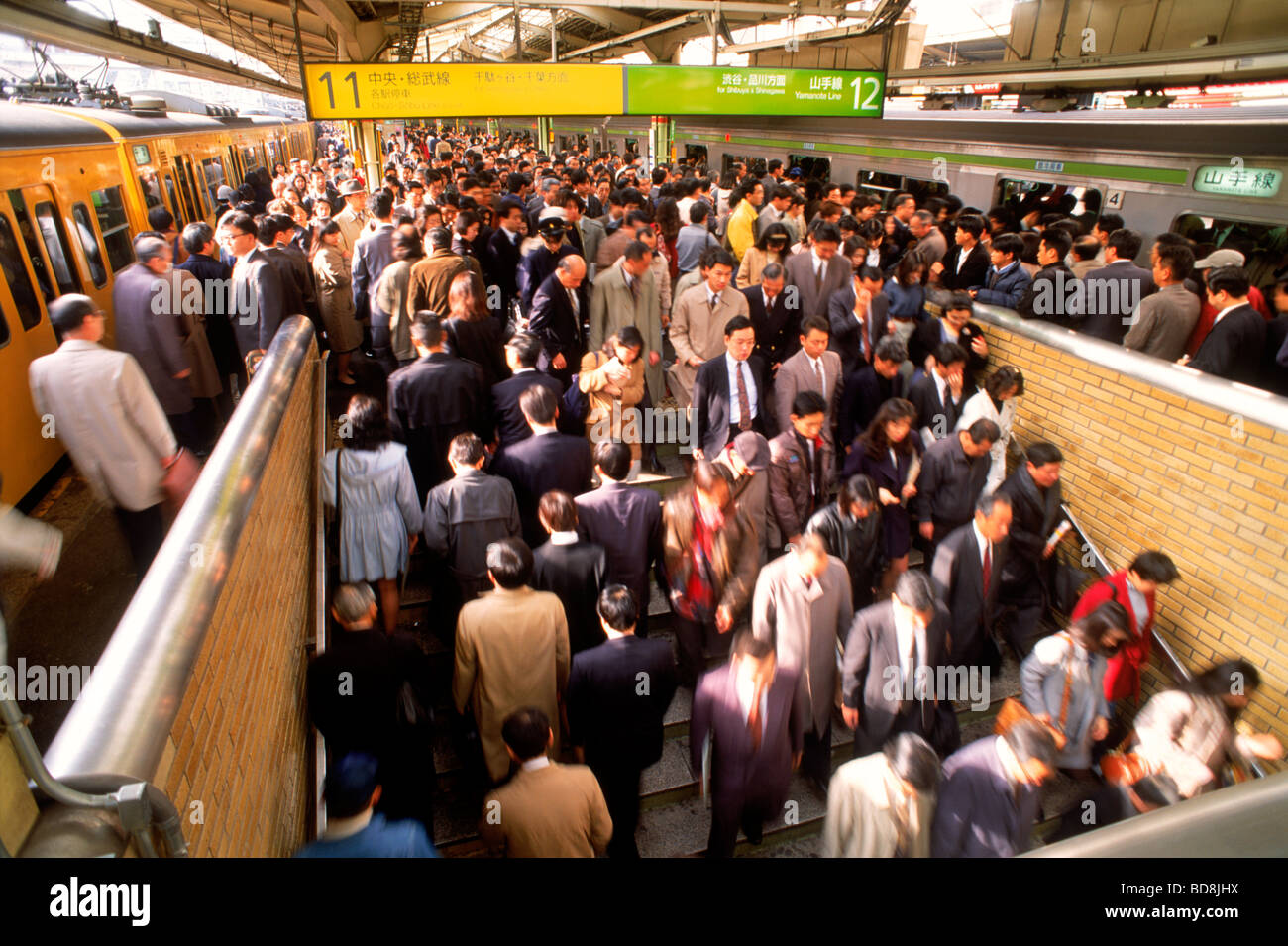 Commuter traffic entering and leaving in motion at city subway station in Tokyo Stock Photo