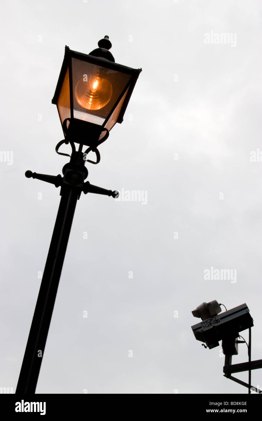 old victorian style gas lamp with CCTV remote control surveillance camera London - Stock Image