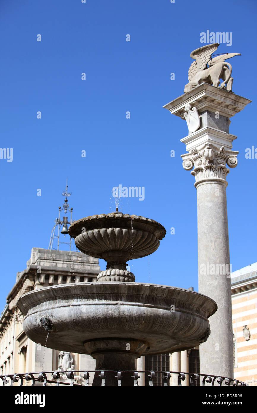 Fountain and Lion of saint Mark in Piazza della Libertà, Udine, Italy - Stock Image