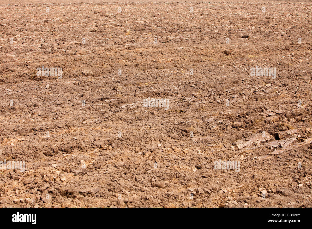 Ploughing soil for farming helps release C02 into the atmosphere and contributes to climate change - Stock Image