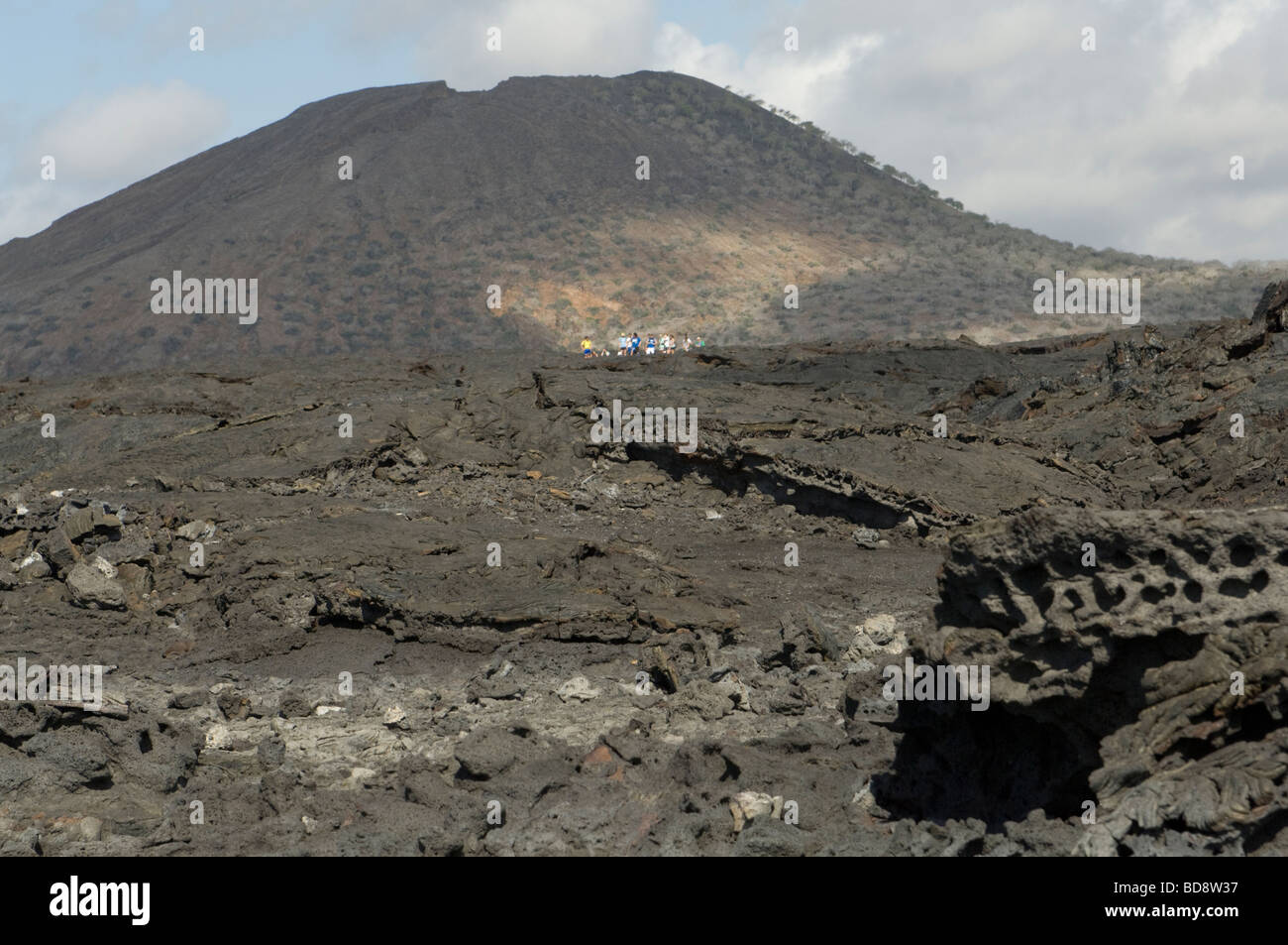 Lava field with volcanic cone in the background  Sullivan Bay Santiago Island Galapagos Ecuador Pacific Ocean South - Stock Image